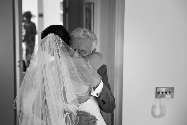 Father of the bride sees his daughter in her wedding dress for the first time at Hilltop Country House
