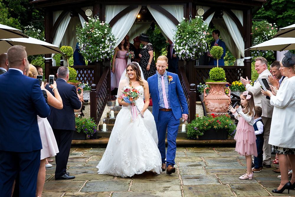 The bride and groom are married at Gibbon Bridge in Clitheroe