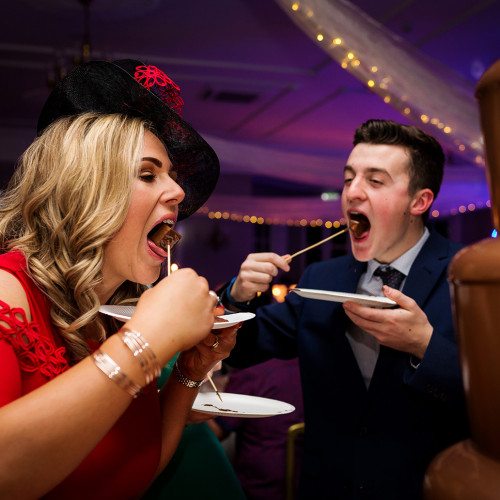 Guests raid the chocolate fountain during a Statham Lodge Wedding