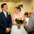 Kellie and Mark laughing during the ceremony of their wedding at Hotel Smokies Park in Manchester