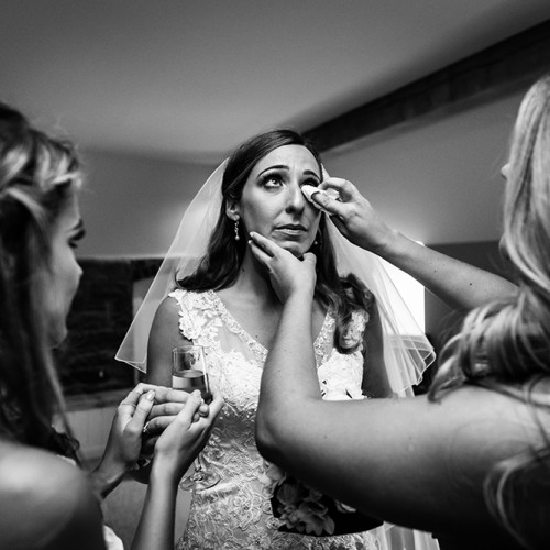 An emotional bride during the bridal preparations at Tower Hill Barns in Wales