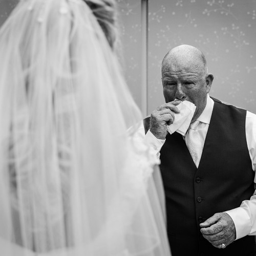 An emotional father of the bride sees his daughter for the first time before a Saddleworth Wedding