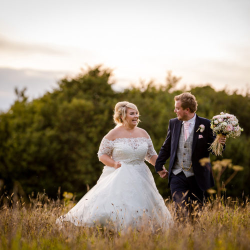 The bride & groom enjoy the sunset at Rivington Barn