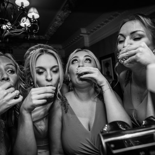 The bridal party doing shots at Inglewood Manor in Merseyside