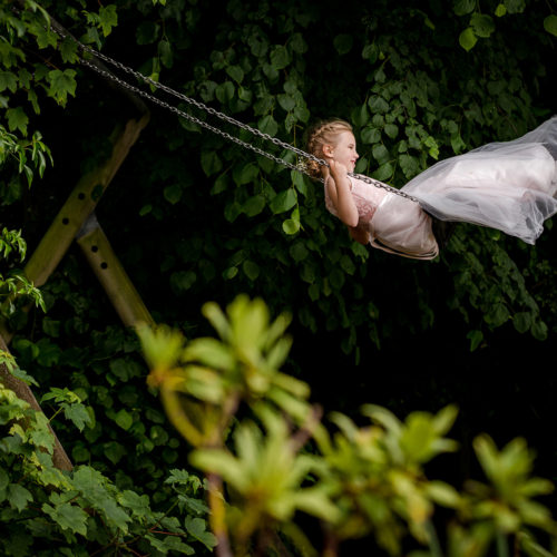 Swinging flower girl at The Villa in Wrea Green