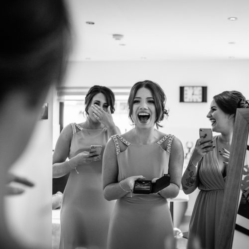 The bridesmaids see the bride in her dress for the first time at Browsholme Hall