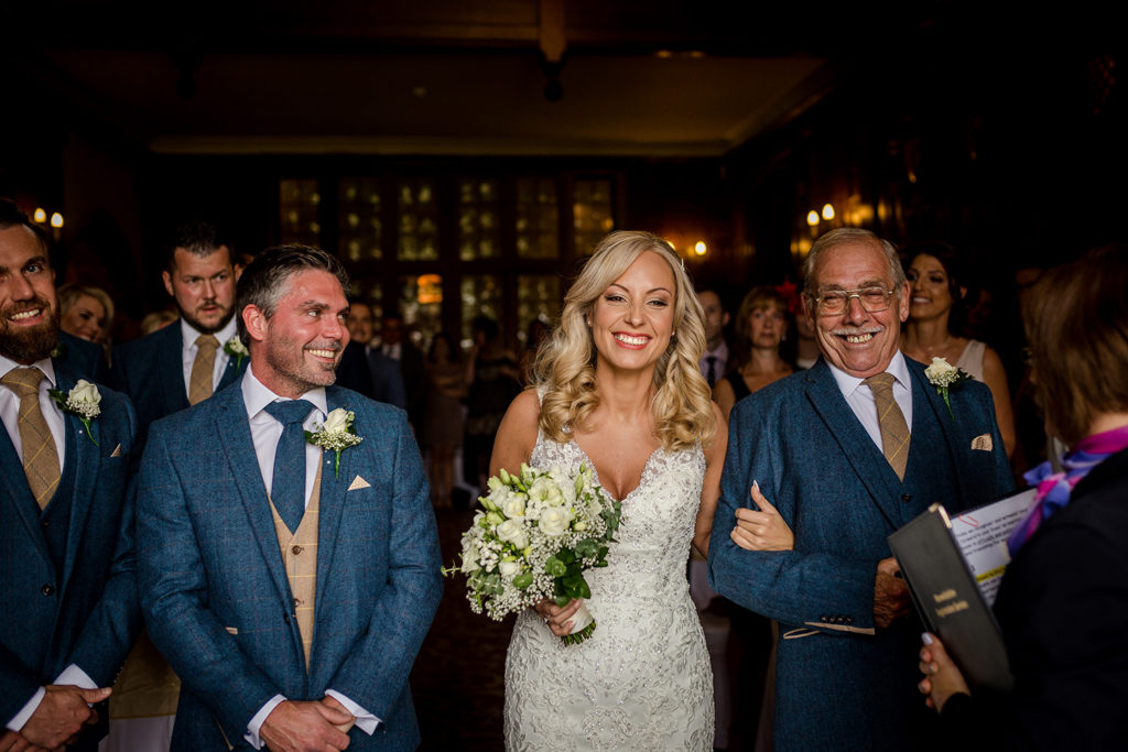 The bride arrives at the Billesley Manor Hotel in Warwickshire