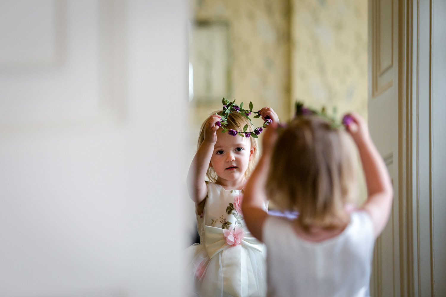Flower girl getting ready at Eaves Hall