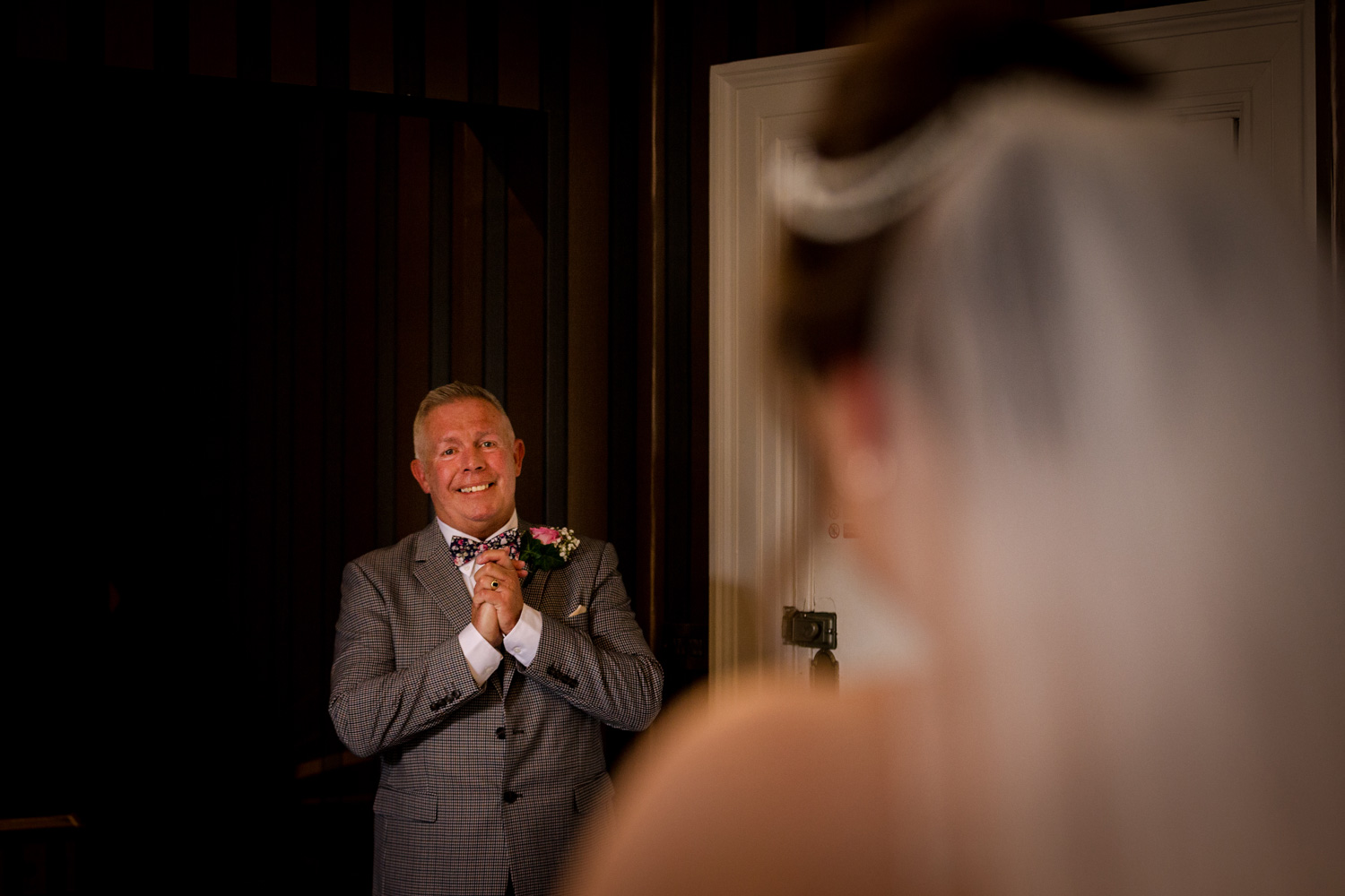 Father of the bride sees his daughter in her dress at Eaves Hall