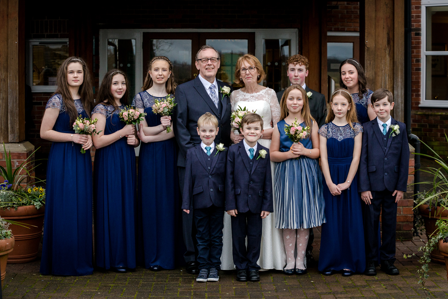 The bride and groom with their grandchildren
