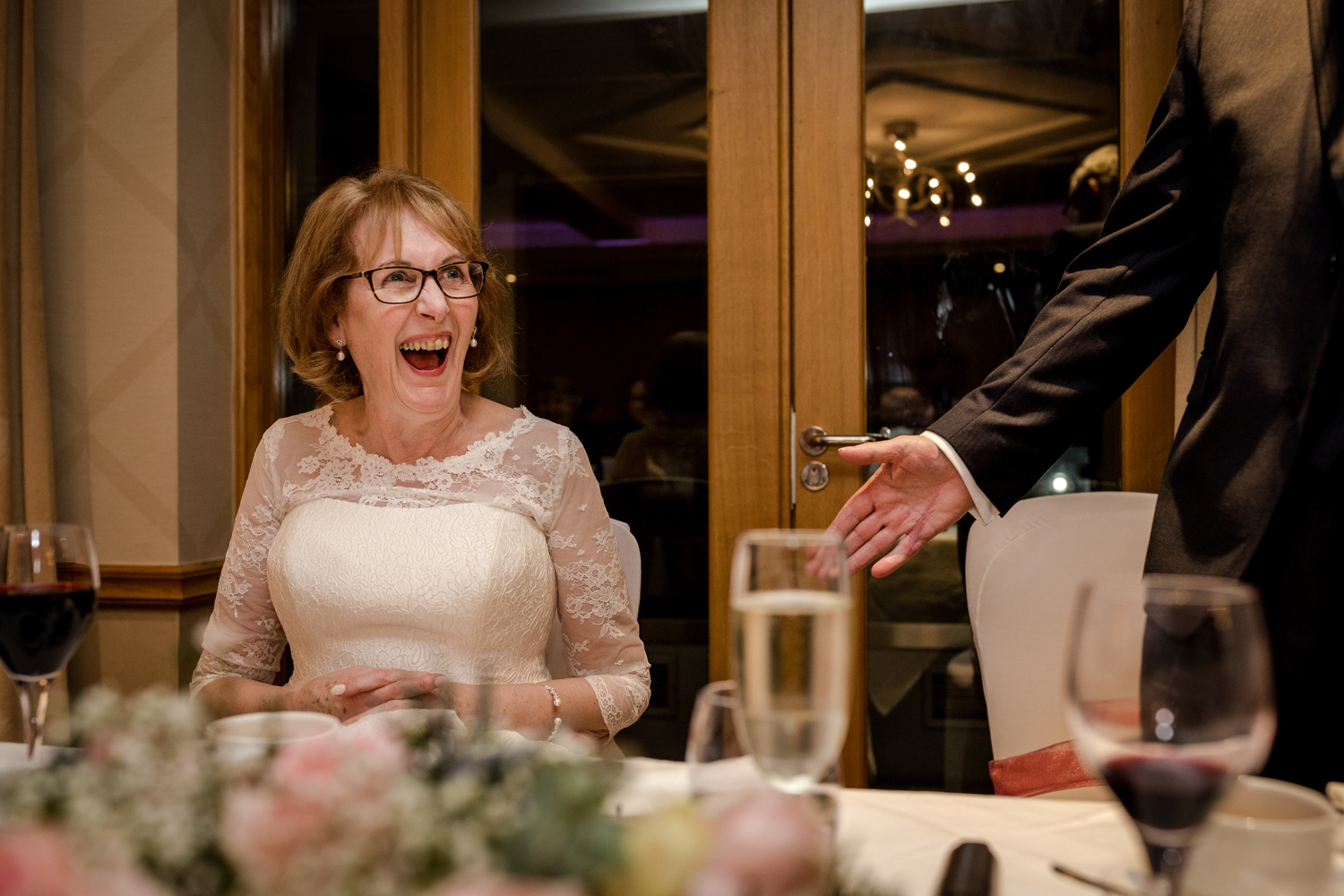 Bride laughing during the speeches at the Cottons Hotel