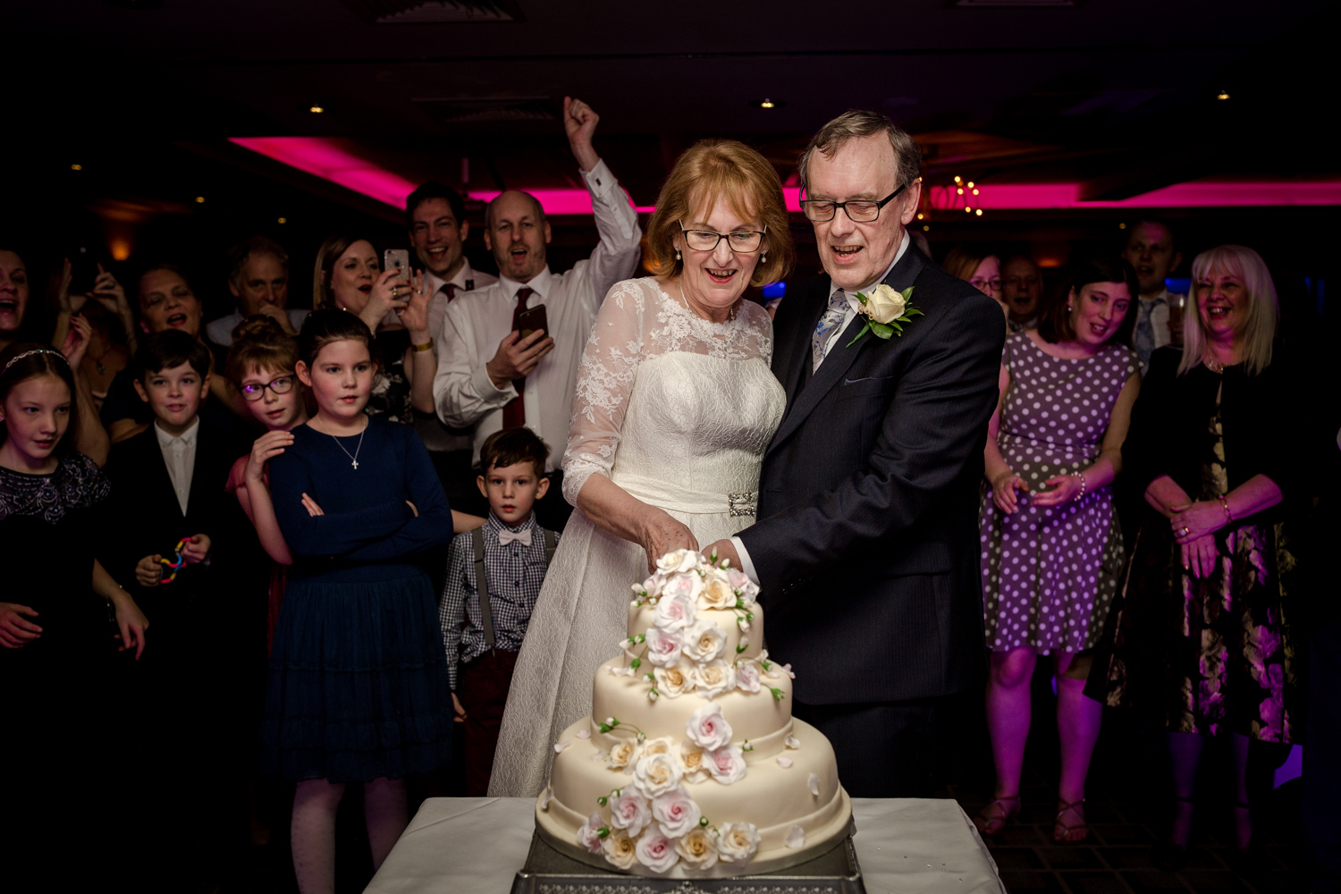 Cutting of the wedding cake at the Cottons Hotel