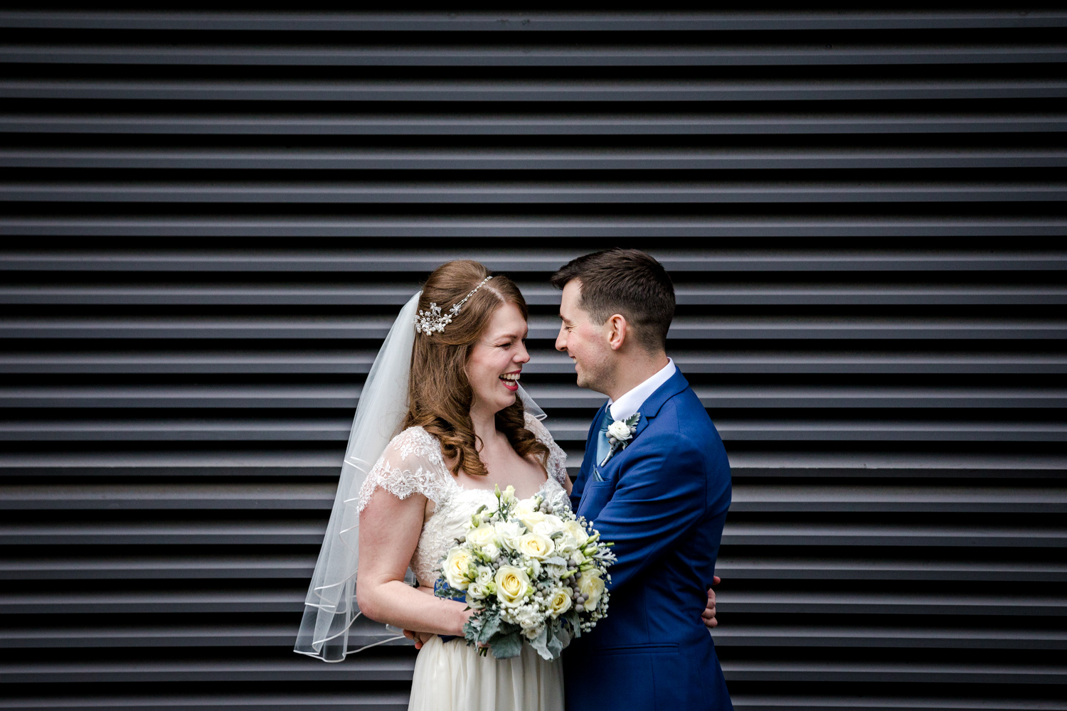 The bride and groom outside great John street hotel