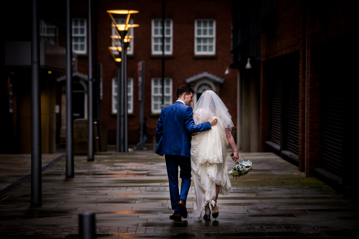 A wedding day walk in rainy Manchester