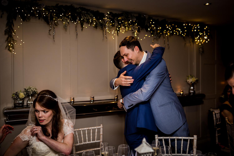 Big hug for the groom during a great John street hotel wedding