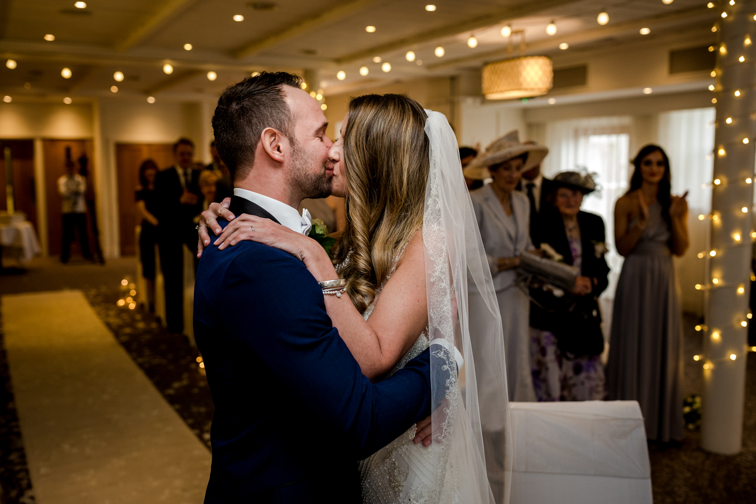 The bride and groom kissing during a winter wedding at Stanley House