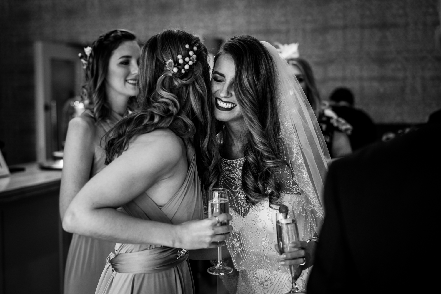Kisses for the guests during a winter wedding at Stanley House