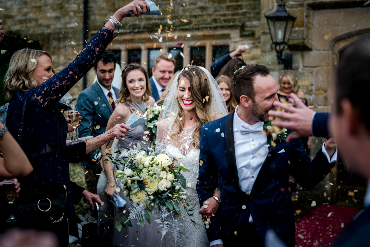 Confetti time during this snowy wedding at Stanley House