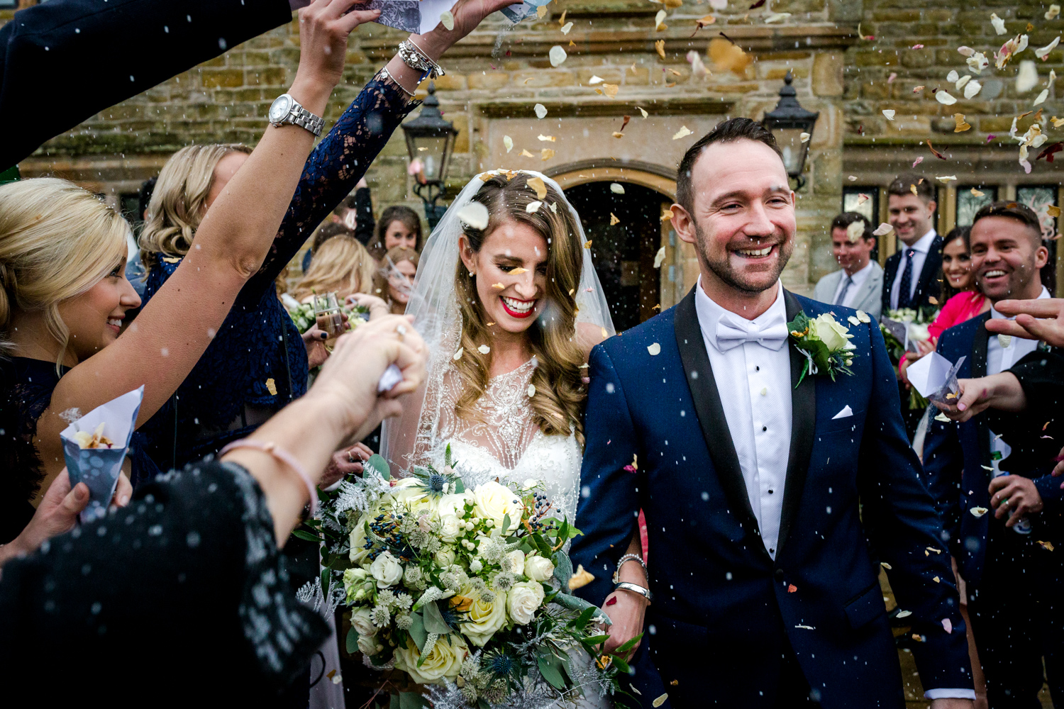 Confetti and bubbles during a winter wedding at Stanley House