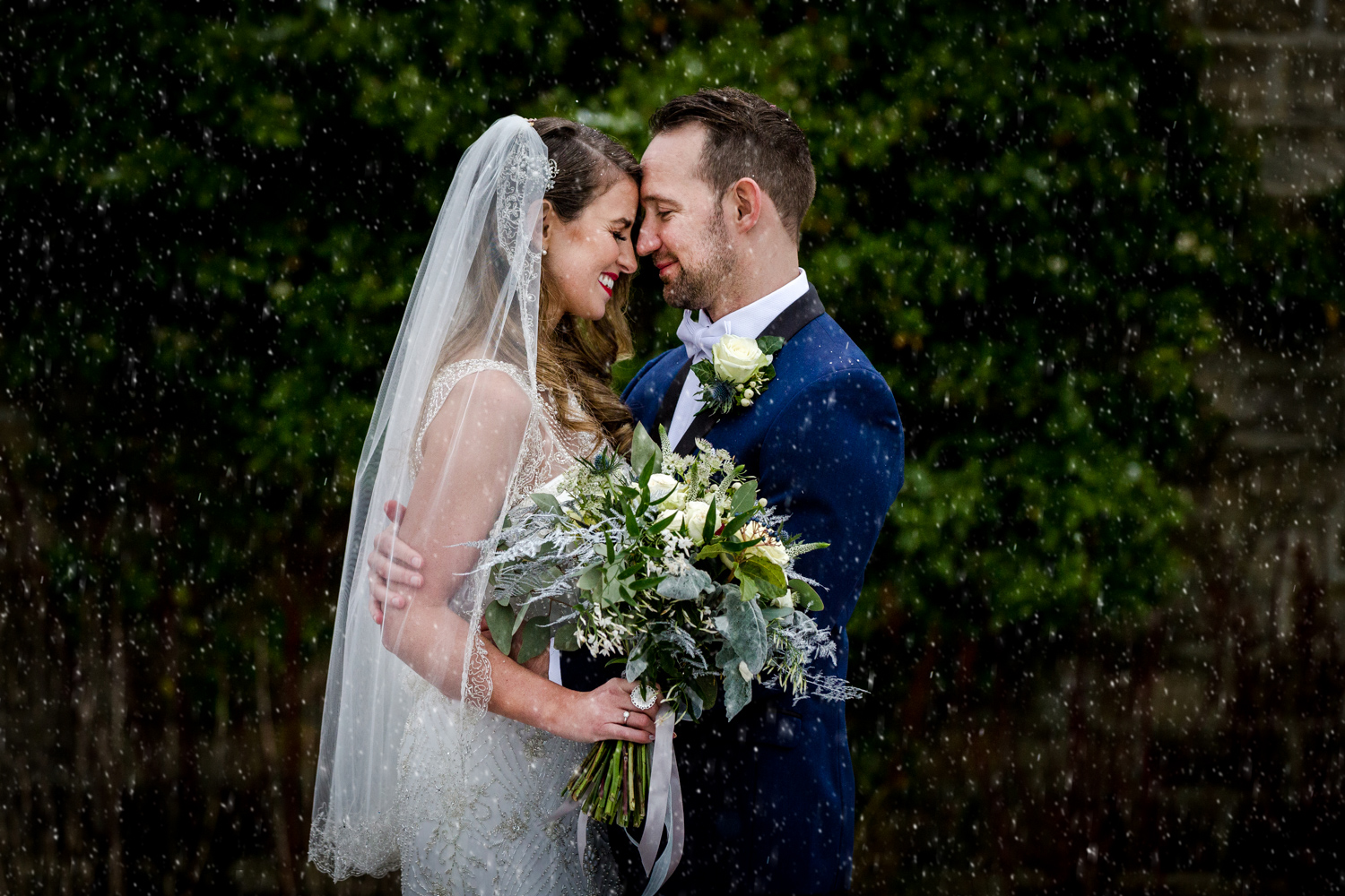 The bride and groom during a snowy winter wedding at Stanley House