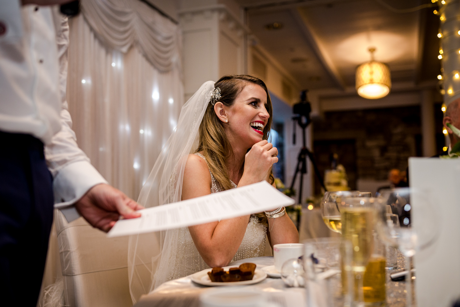 The bride laughing at the grooms speech during a winter wedding at Stanley House