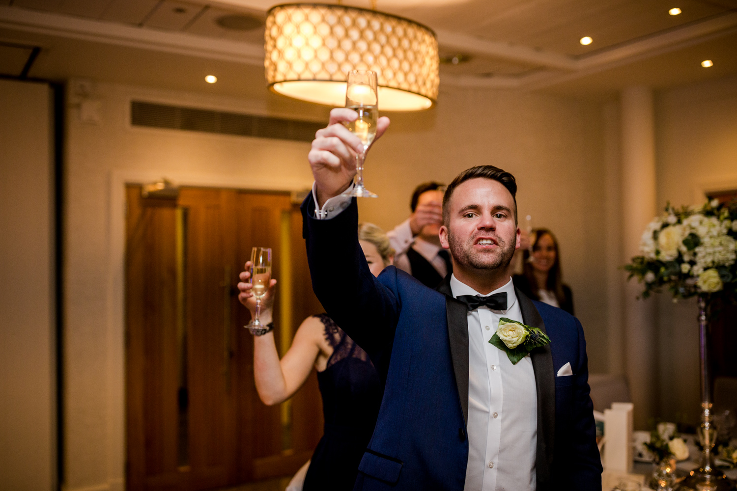 Cheers! The guests raise a toast during a winter wedding at Stanley House