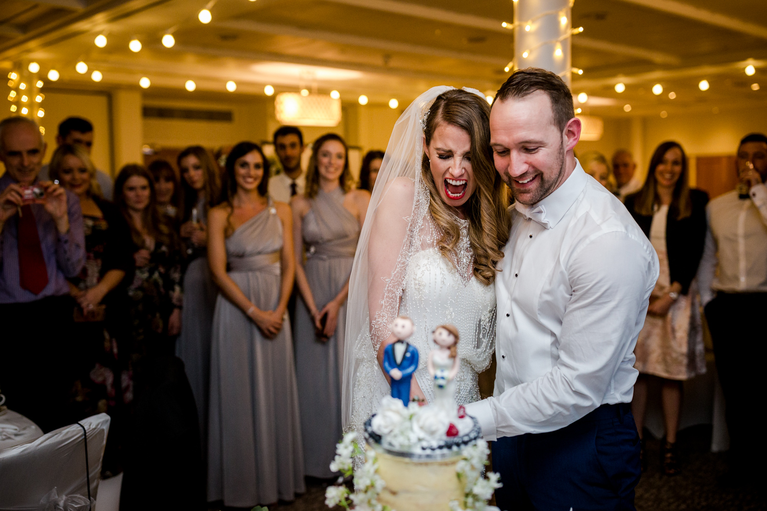 Cutting the cake during a winter wedding at Stanley House