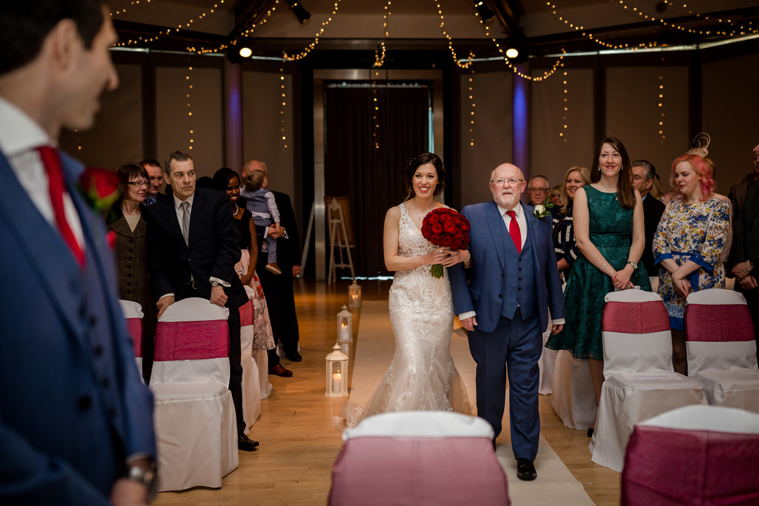 The bride walks down the aisle during her Lowry Wedding