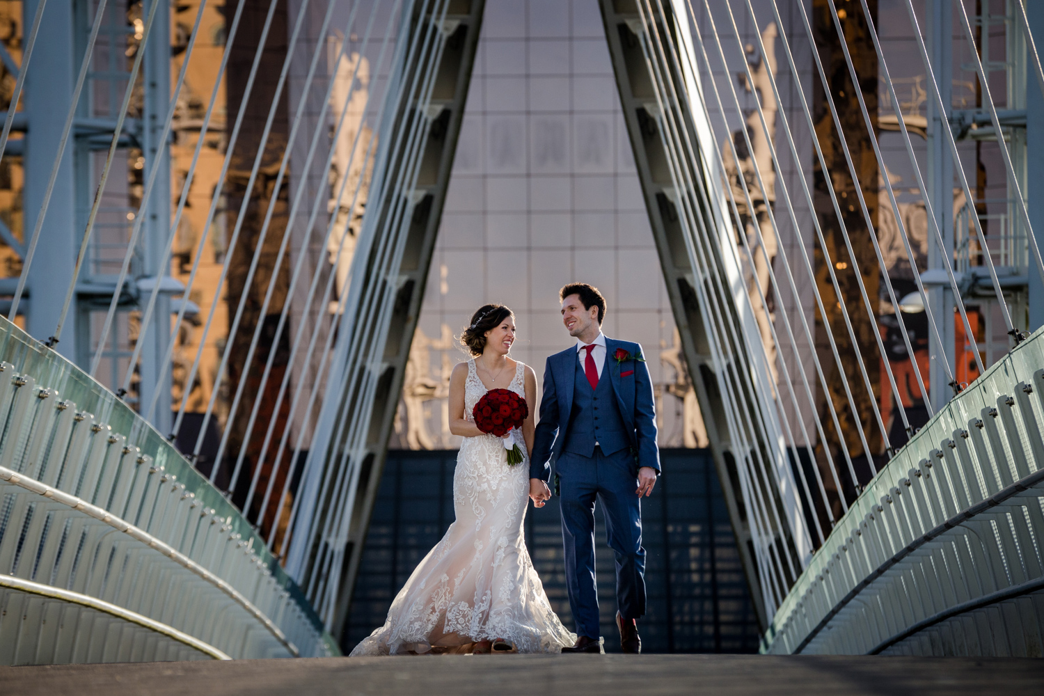The bride and groom on the bridge during their Lowry Wedding