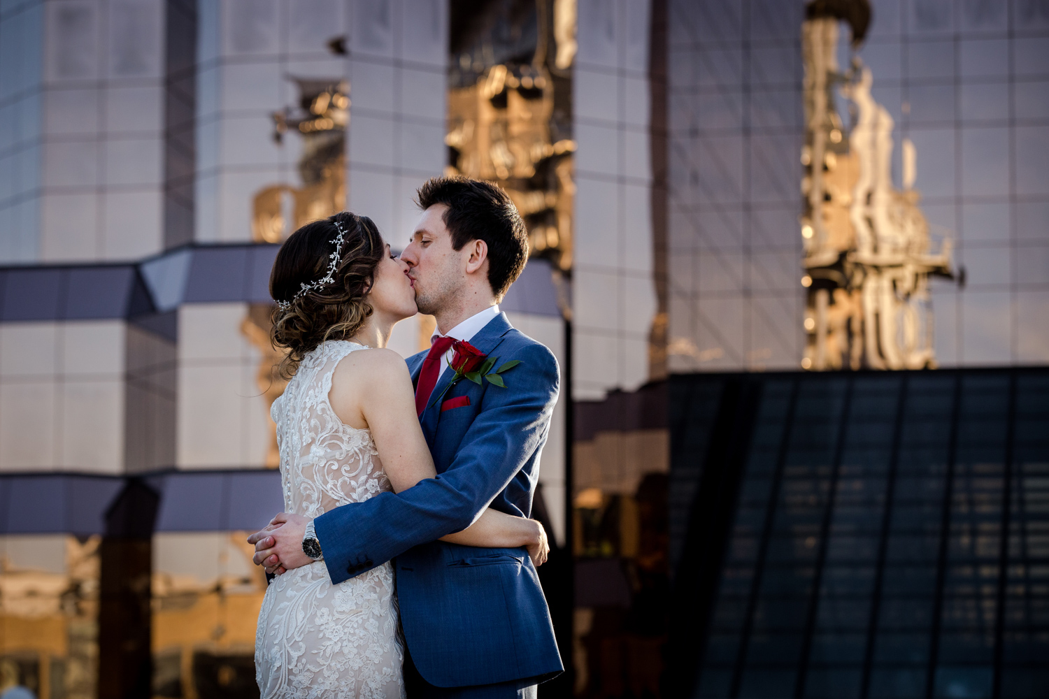 The bride and groom kiss during their Lowry Wedding