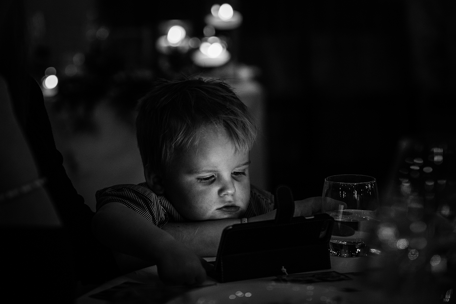 Child on an iPad at Holmes Mill