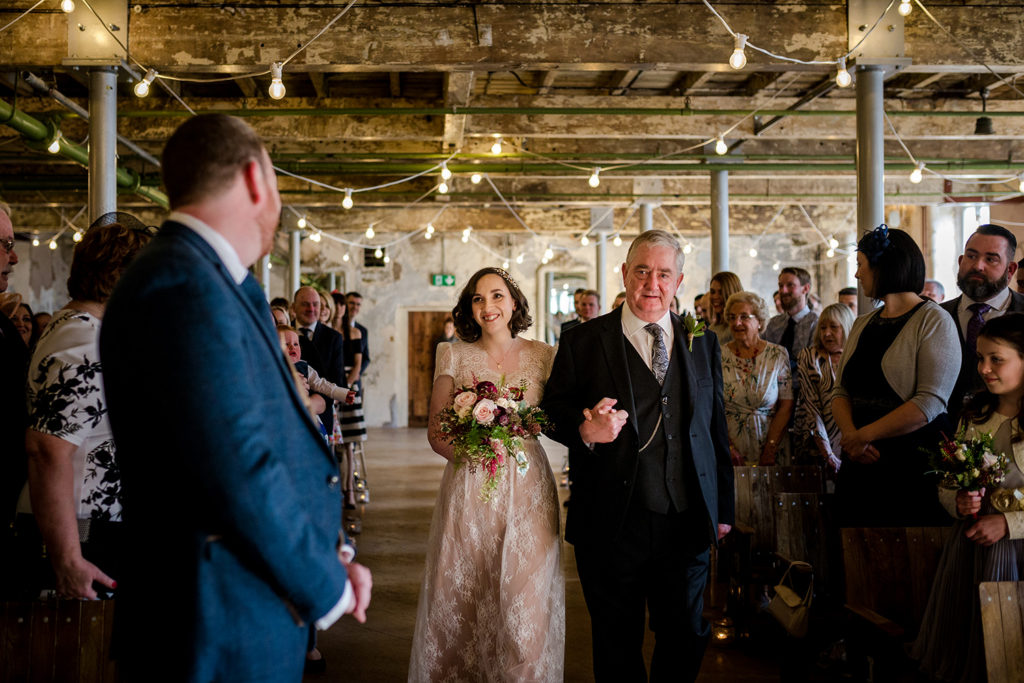 Here comes the bride during a Holmes Mill Wedding