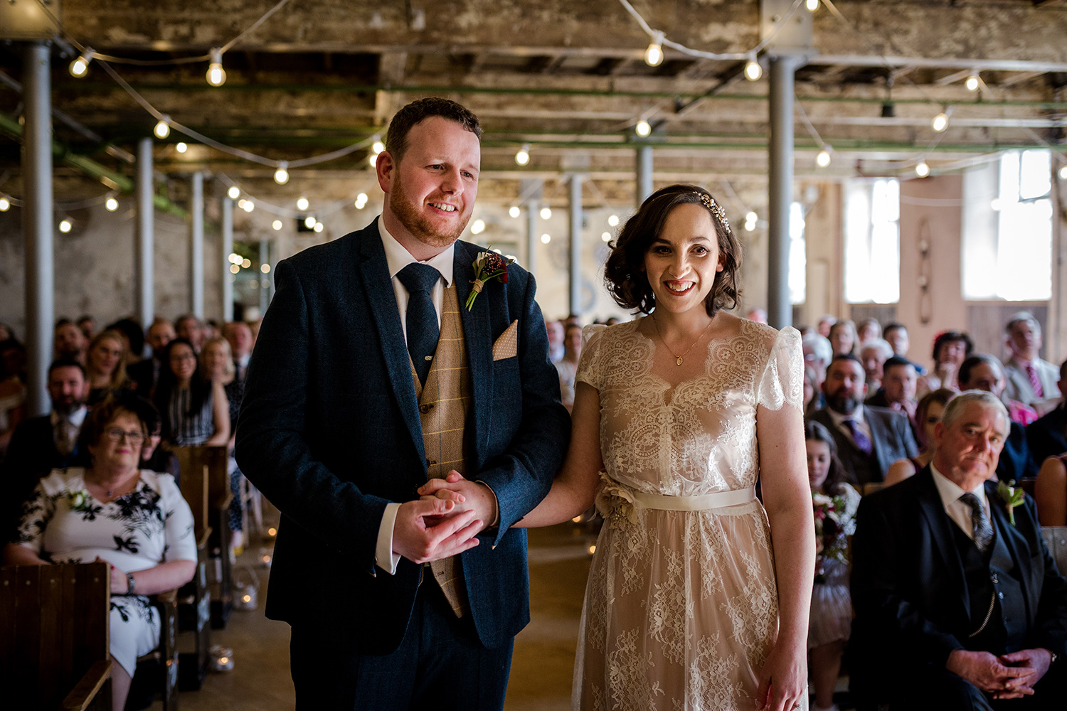 The wedding ceremony at holmes mill in Clitheroe