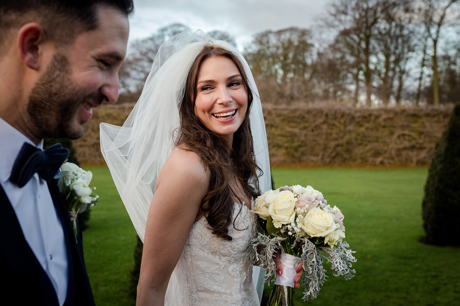 The bride and groom go for a stroll within the grounds of Knowsley Hall