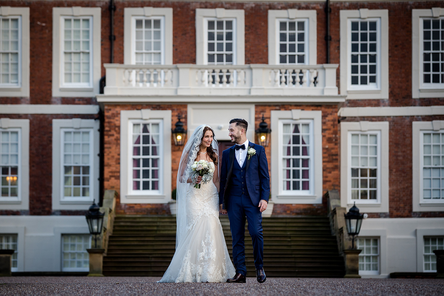 The bride and groom outside Knowsley Hall on their wedding day