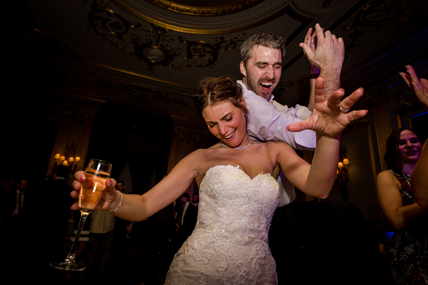 The bride with a friend on the dance floor at Knowsley Hall