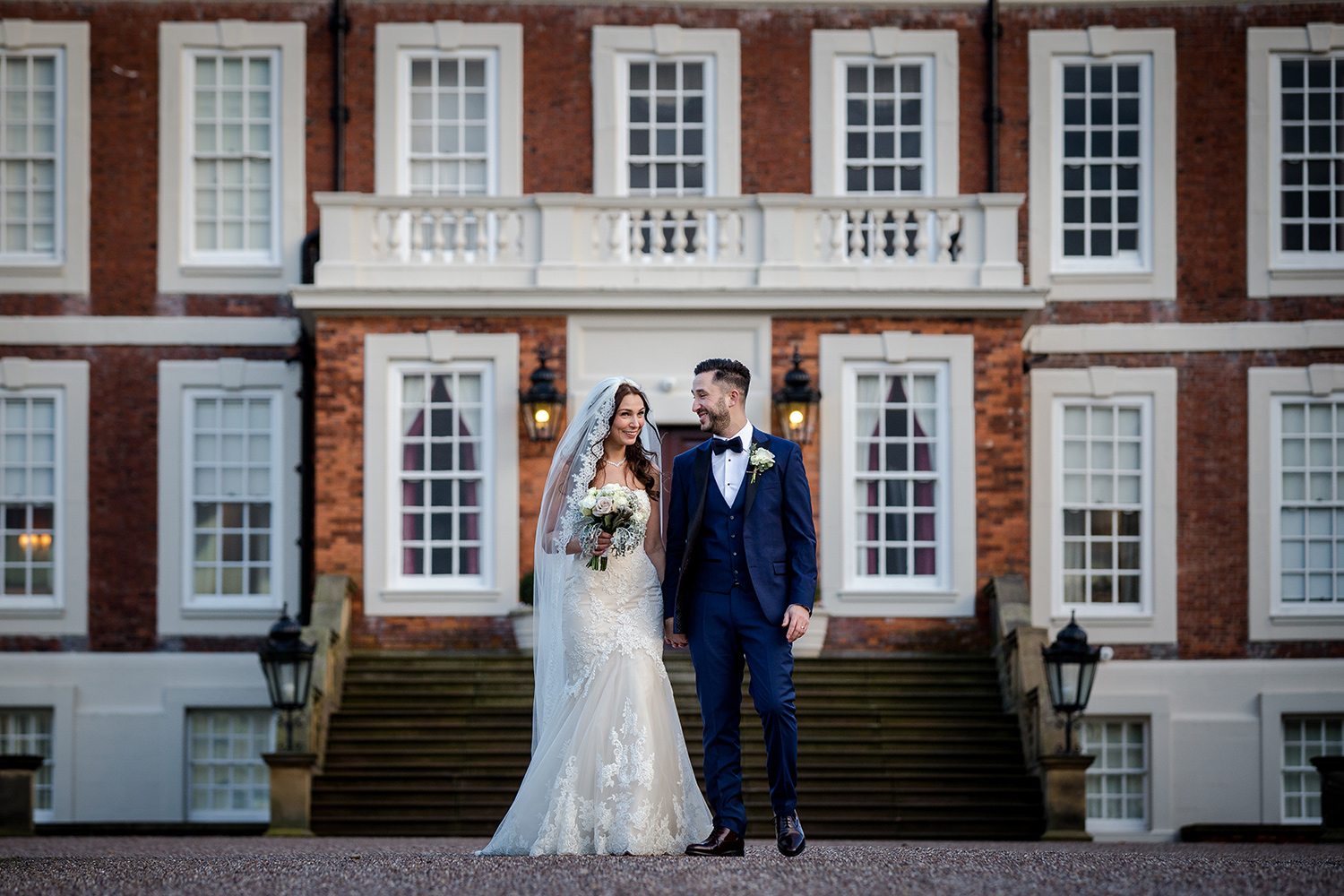 The bride and groom go for a stroll during their Knowsley Hall Wedding