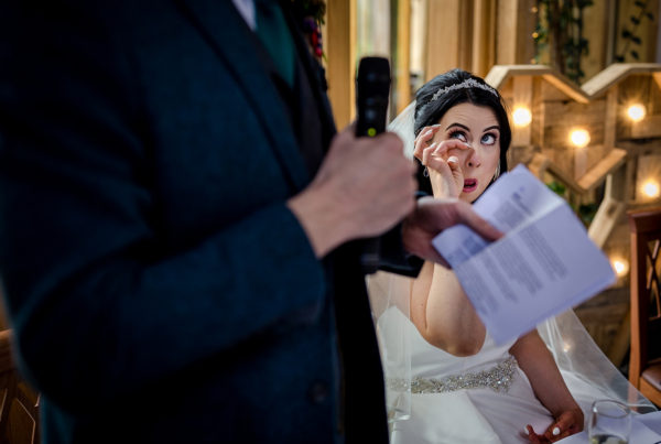 The bride sheds a tear during a wedding at the Oak Tree in Peover