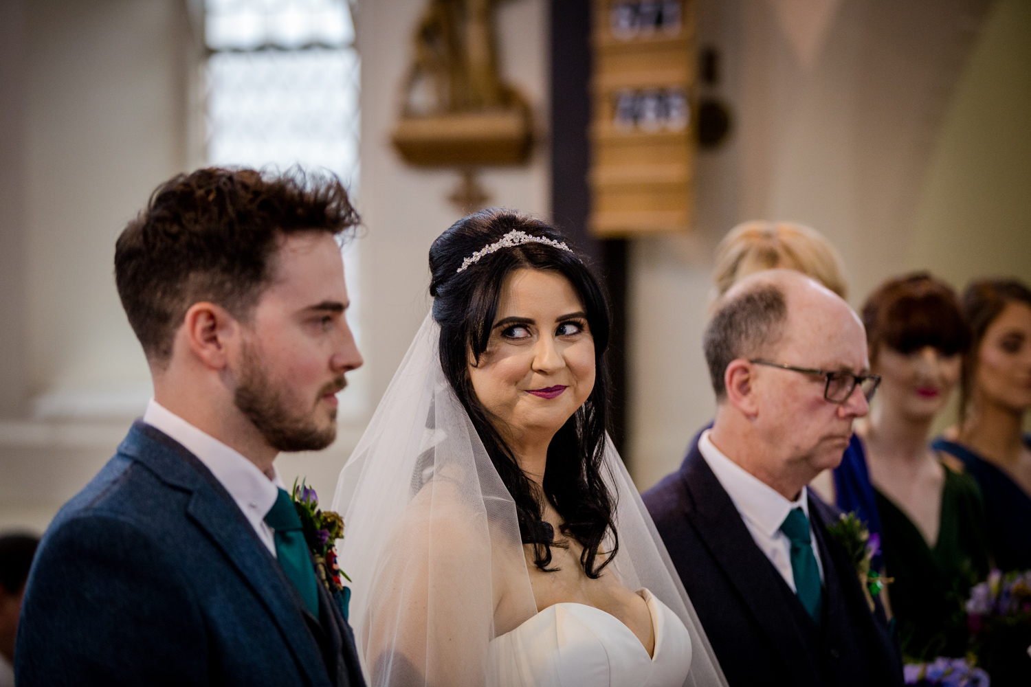 Bride looking at her husband during a church wedding in Middlewich