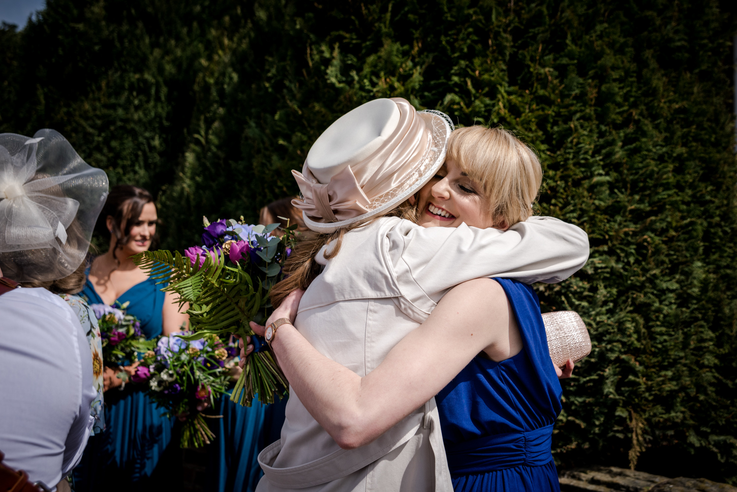 Bridesmaid hugs during an Oak Tree Peover Wedding