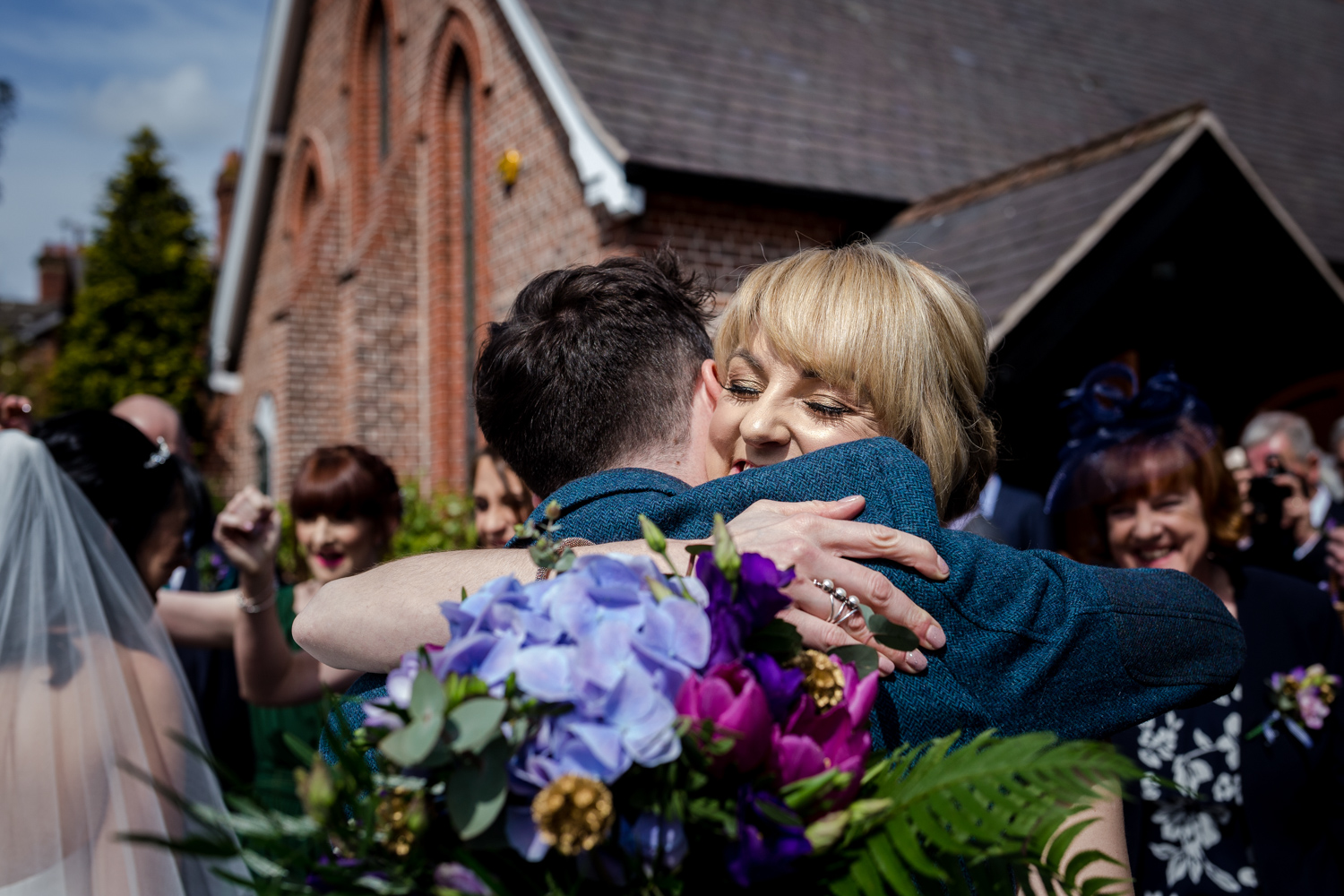 Big hugs after the wedding ceremony