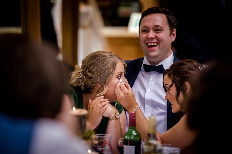 Bridesmaids fixing their eyelashes during an Oak Tree Peover Wedding