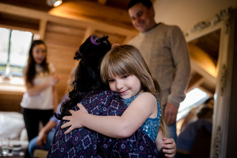 Flower Girl hugs during an Oak Tree Peover Wedding