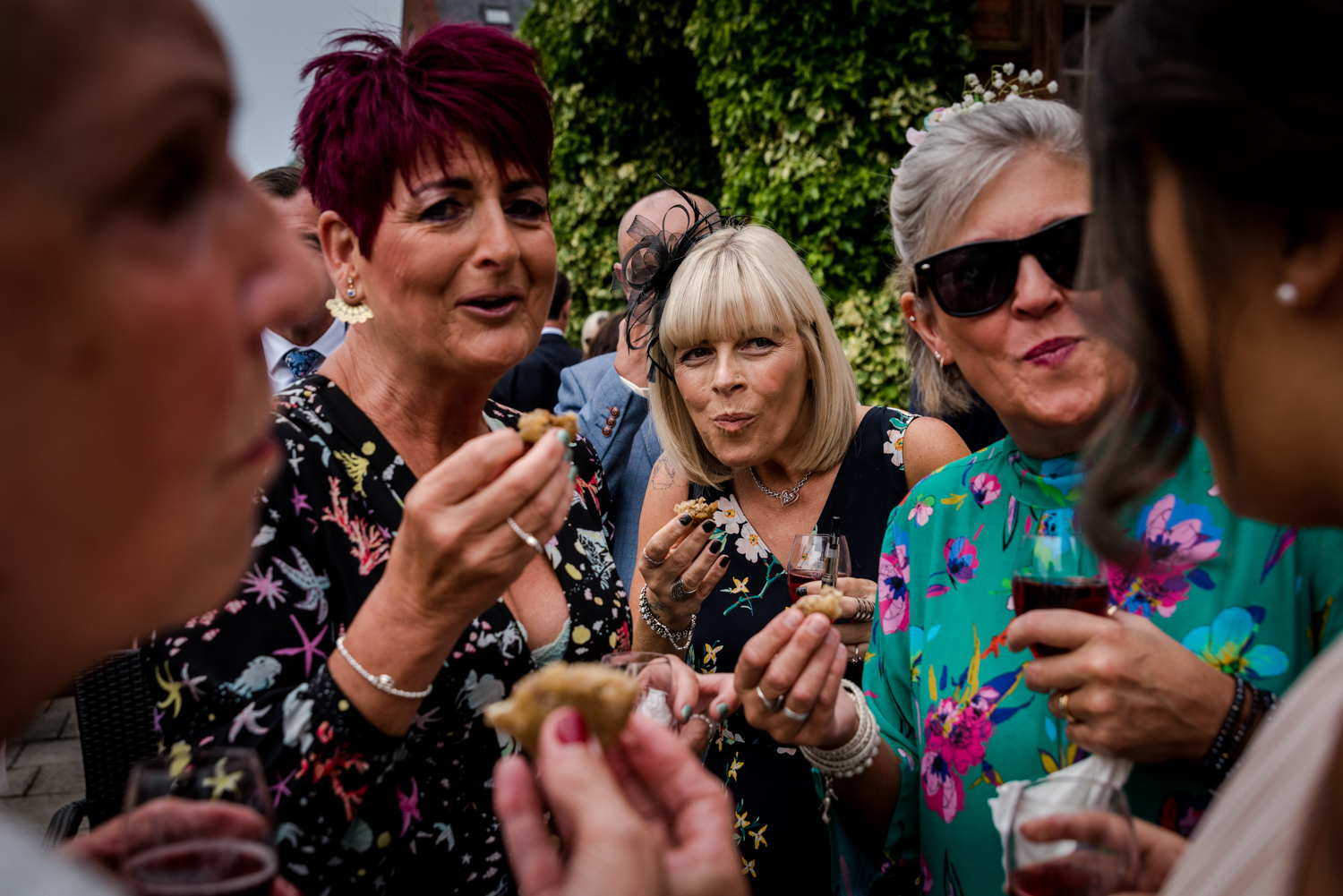 Guests enjoying food at a Nunsmere Hall wedding reception