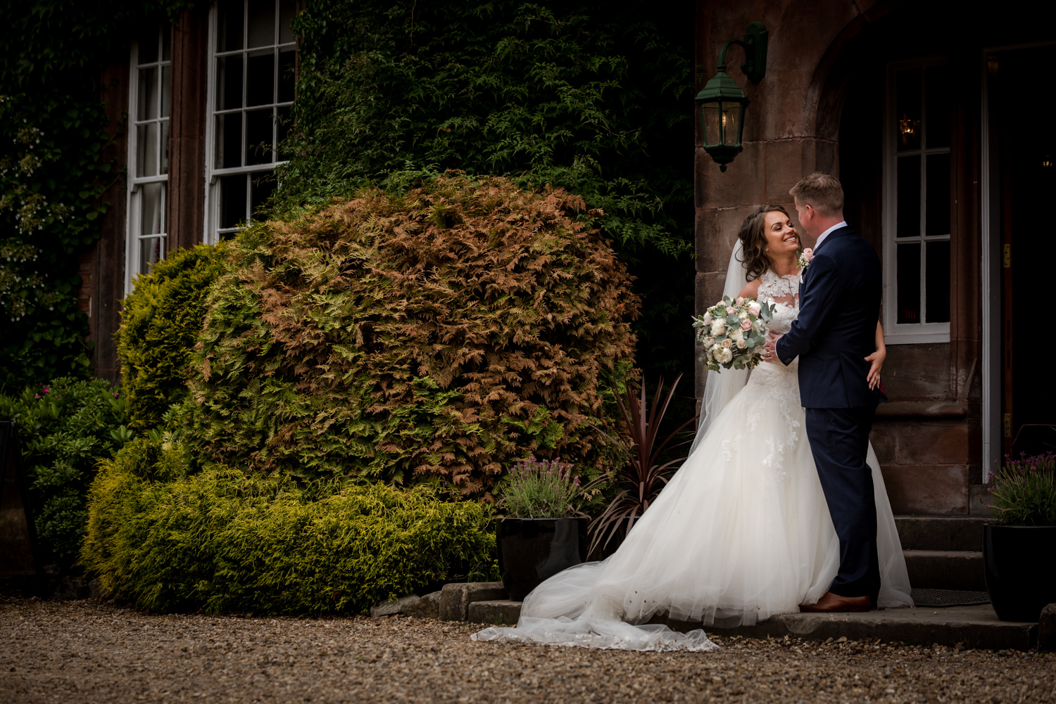 Bride and groom at Nunsmere Hall in Cheshire