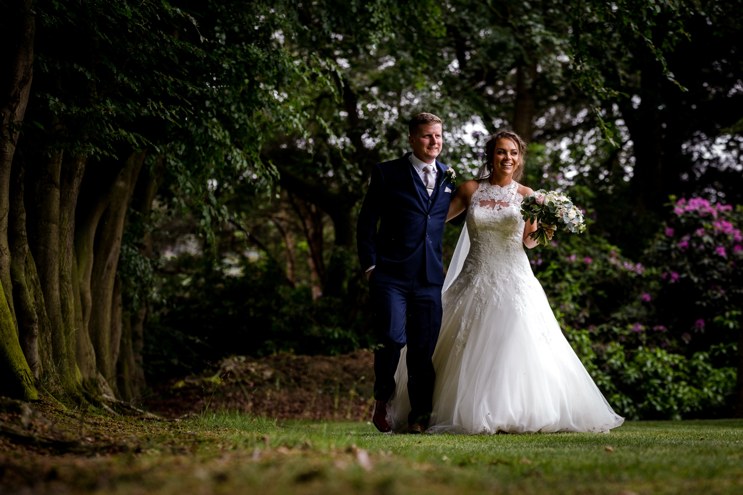 Bride and groom go for a stroll during their Nunsmere Hall Wedding Reception