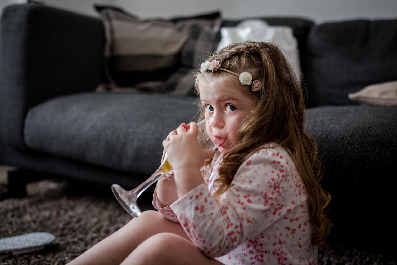 Flower Girl drinking at a Nunsmere Hall Wedding Reception