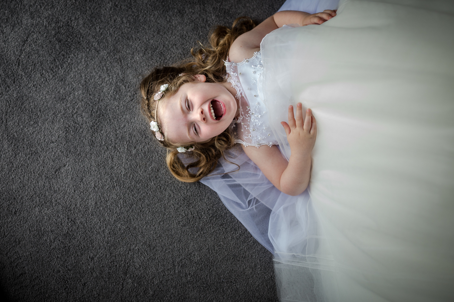 Excited flower girl at a Nunsmere Hall Wedding Reception