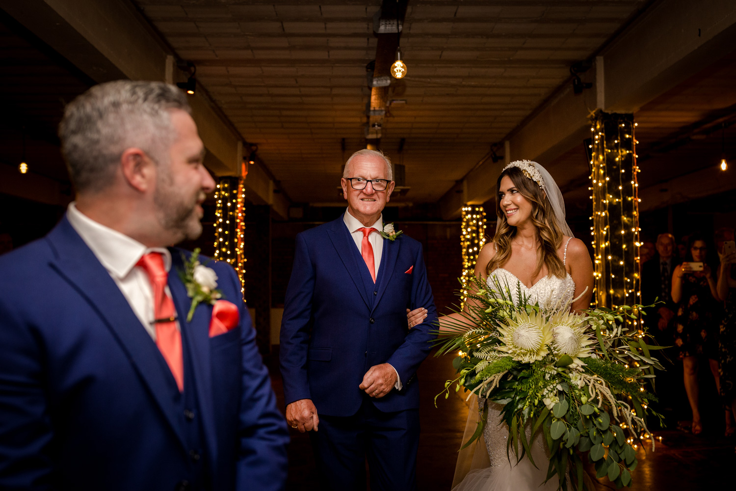 The bride arrives with her dad at Victoria Warehouse in Manchester