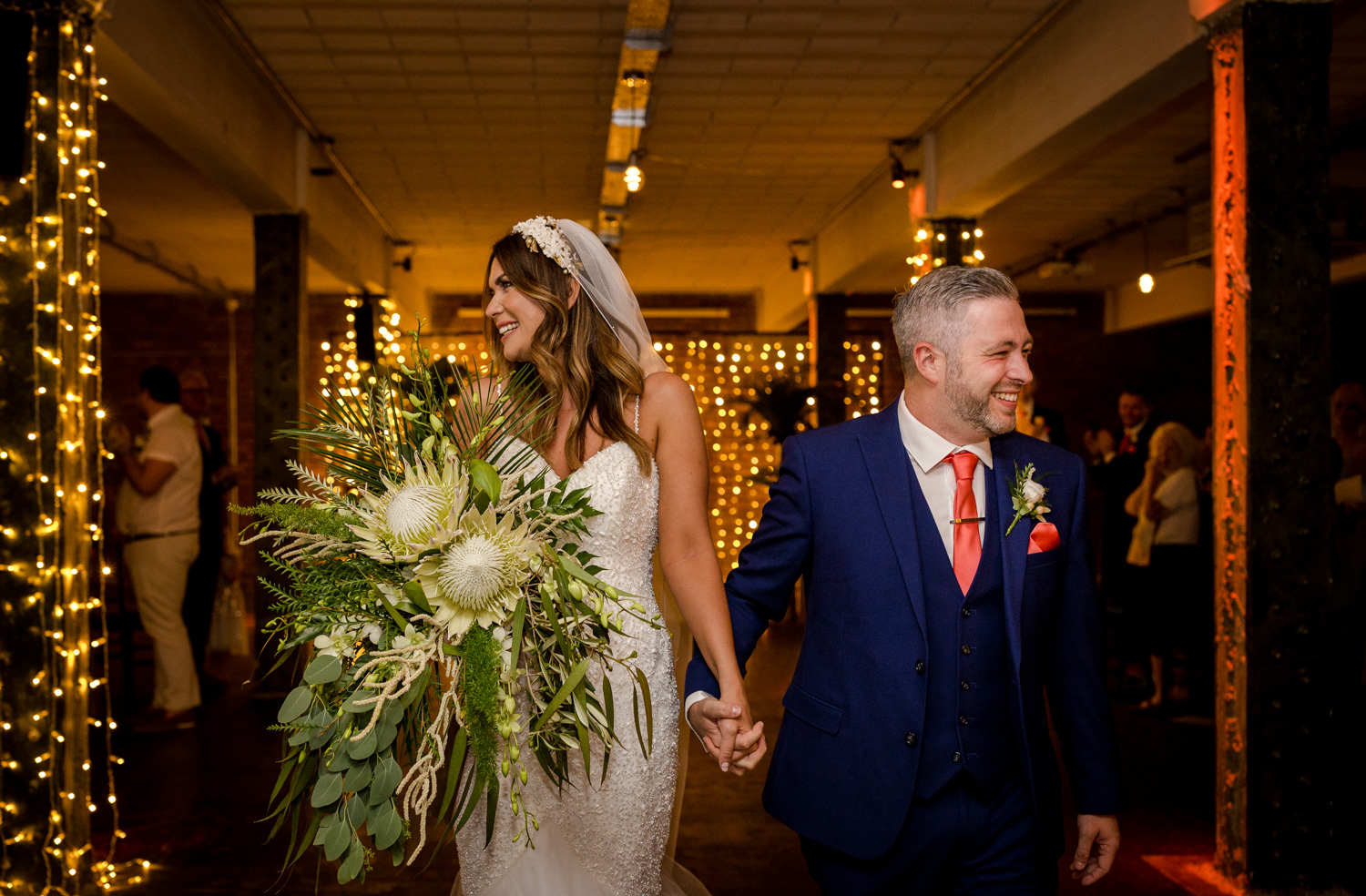Bride and groom walk down the aisle at Victoria Warehouse